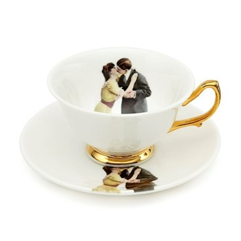 Kissing Couple Teacup and saucer, crisp white/burnished gold details