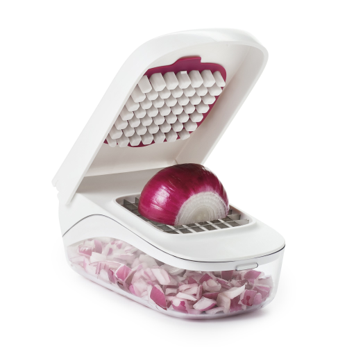 Vegetable chopper with easy pour opening